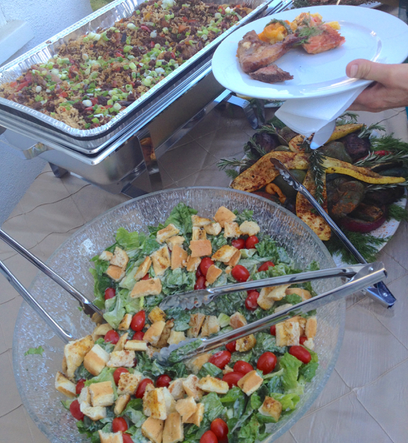 A Guest at Catered BBQ Wedding takes small servings of Smoked Waygu Steak and Salmon, leaving plenty of room on the plate for Salad and Grilled Veggies.