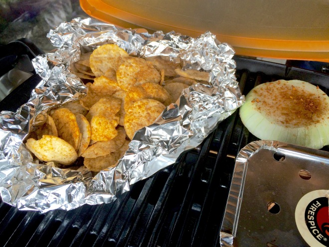 HEROIC! seasoned popchips smoking on the Grill. One thick seasoned slice of Onion to make a fresh Grilled Onion Dip.